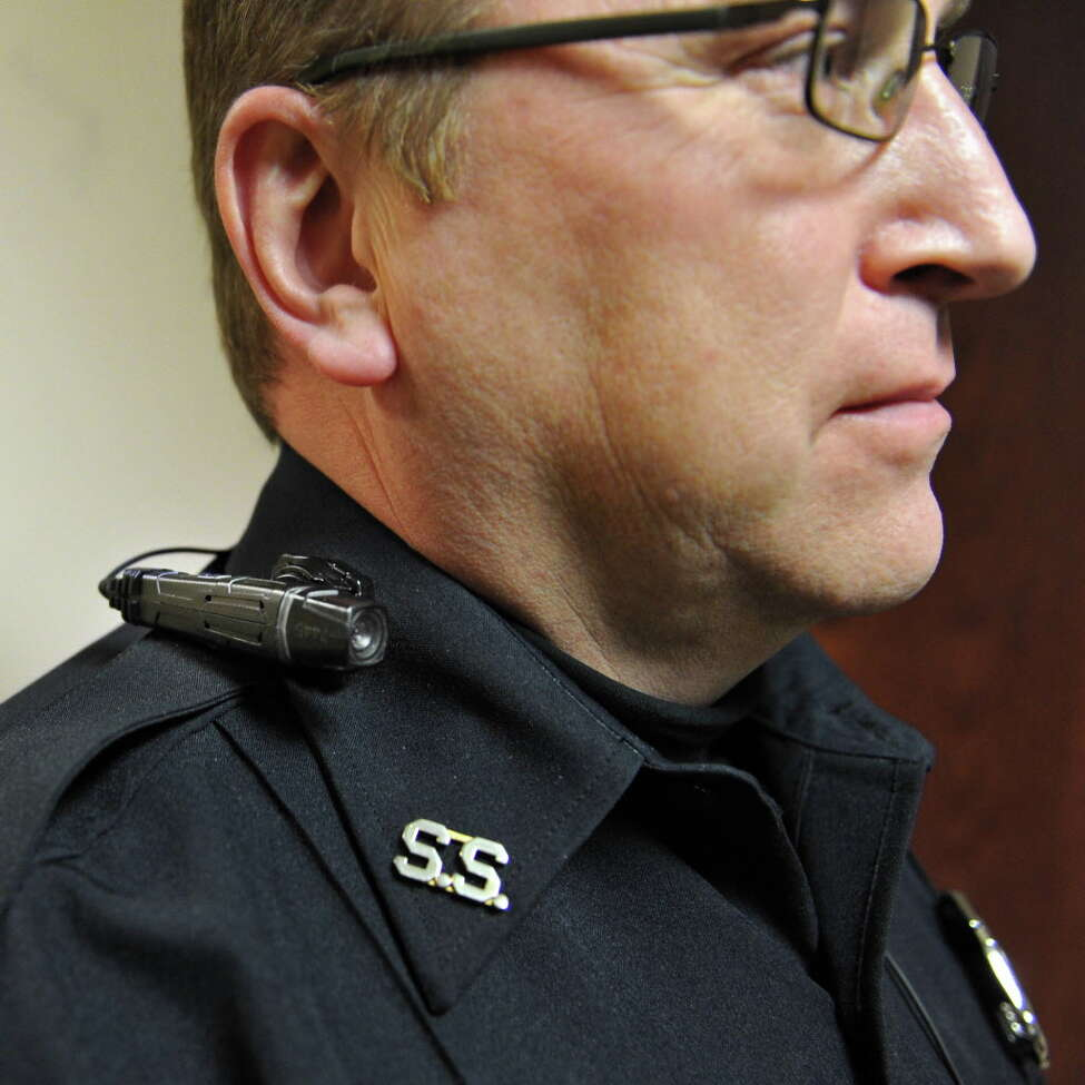 Saratoga Springs patrolman Robert Dennis wears one of his department's body cams attached to his uniform shirt epaulette,Tuesday Dec. 9, 2014, in Saratoga Springs, NY. (John Carl D'Annibale / Times Union)