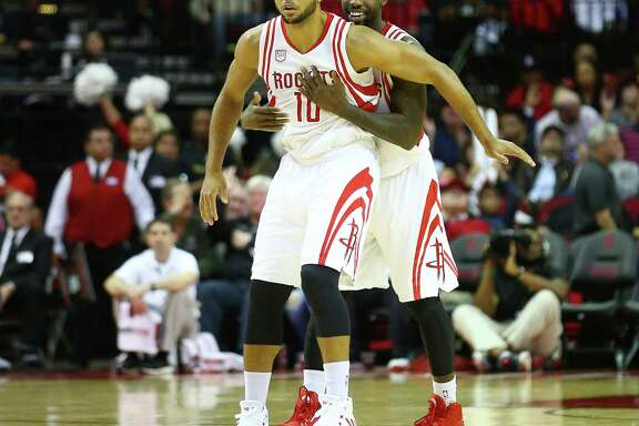Houston Rockets guard Patrick Beverley (2) hugs guard Eric Gordon (10) after Gordon scored during the first quarter of an NBA game at the Toyota Center, Wednesday, Dec. 7, 2016, in Houston. ( Jon Shapley / Houston Chronicle )