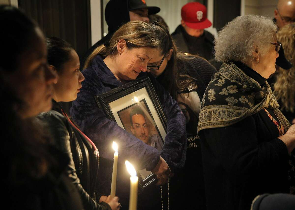 Mary Vega, mother of Alex Vega, hugs Kathy Caballero, her daughter-in-law during a memorial for Alex Vega and Michela Gregory at Vega's family home in San Bruno, Calif., on Wednesday, December 7, 2016. The young couple died in the Ghost Ship warehouse fire in Oakland on Friday, December 2, 2016.