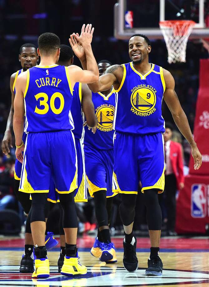 Andre Iguodala #9 of the Golden State Warriors and Stephen Curry #30 celebrate a basket after a timeout against the LA Clippers during the first half at Staples Center on December 7, 2016 in Los Angeles, California. Photo: Harry How, Getty Images