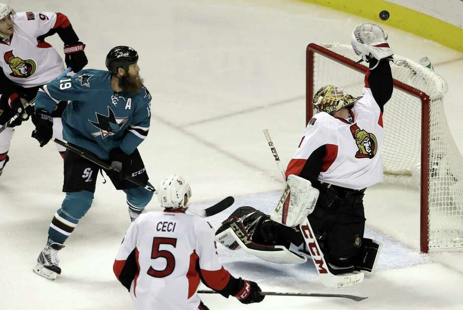 Ottawa Senators goalie Mike Condon, right, reaches for the puck next to San Jose Sharks' Joe Thornton (19) during the third period of an NHL hockey game Wednesday, Dec. 7, 2016, in San Jose, Calif. Ottawa won 4-2. (AP Photo/Marcio Jose Sanchez) Photo: Marcio Jose Sanchez / Associated Press / Copyright 2016 The Associated Press. All rights reserved.
