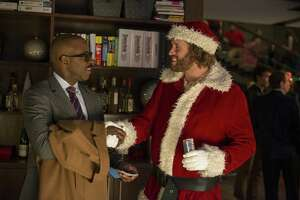 """This image released by Paramount Pictures shows Courtney B. Vance, left, and T.J. Miller in a scene from """"Office Christmas Party."""" (Glen Wilson/Paramount Pictures via AP)"""