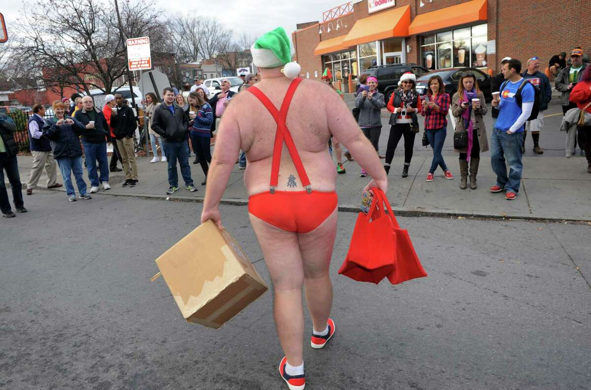 Now I may go blind: What was this man thinking? Santa in a Speedo AND with a tramp stamp? OMG. In reality he was heading into an annual event -- a Santa Speedo Spring at a winter festival in Albany, N.Y. But still ...