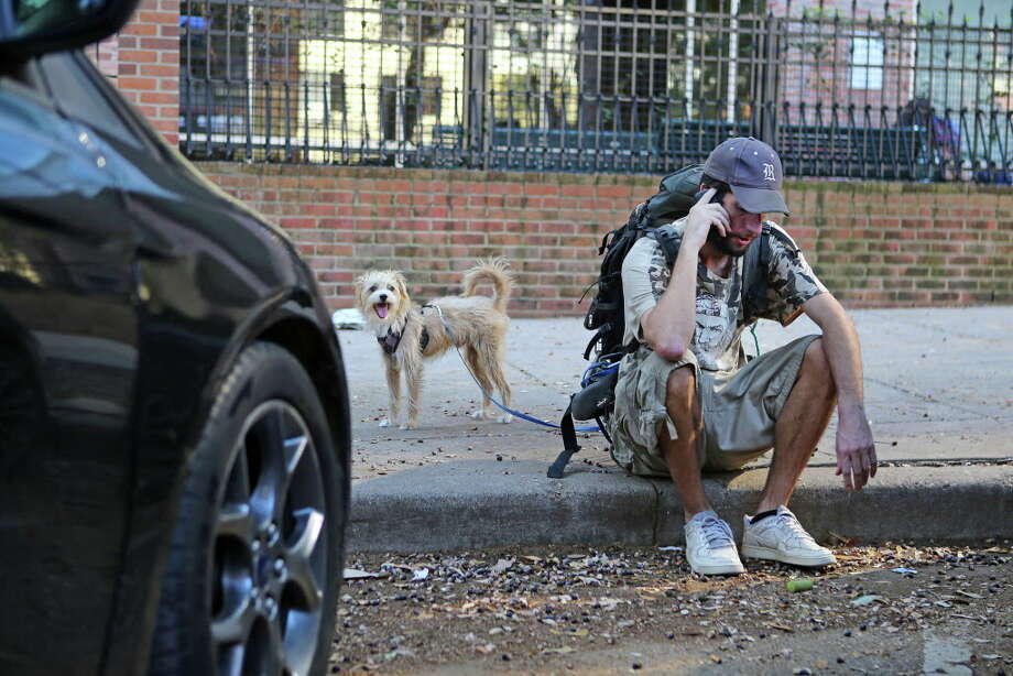 After being turned away at a homeless-services organization, Patrick Gillespie seeks other help. Gillespie was growing frustrated, but his dog Franklin remained undaunted. Photo: Mark Mulligan, Houston Chronicle / © 2016 Houston Chronicle