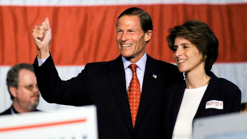 Attorney General Richard Blumenthal, left, holds hands with his wife Cynthia Blumenthal, and waves t