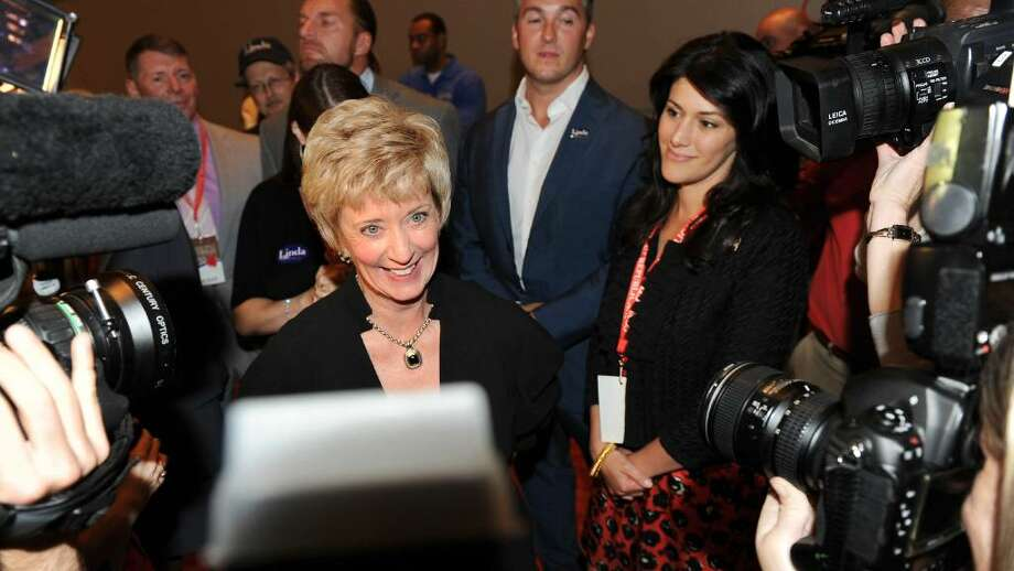 US Senate candidate Linda McMahon stands in the center of the media as she waits to hear the results of the nomination proccess at the GOP convention in downtown Hartford, Conn. on Friday May 21, 2010. Photo: Christian Abraham / Connecticut Post