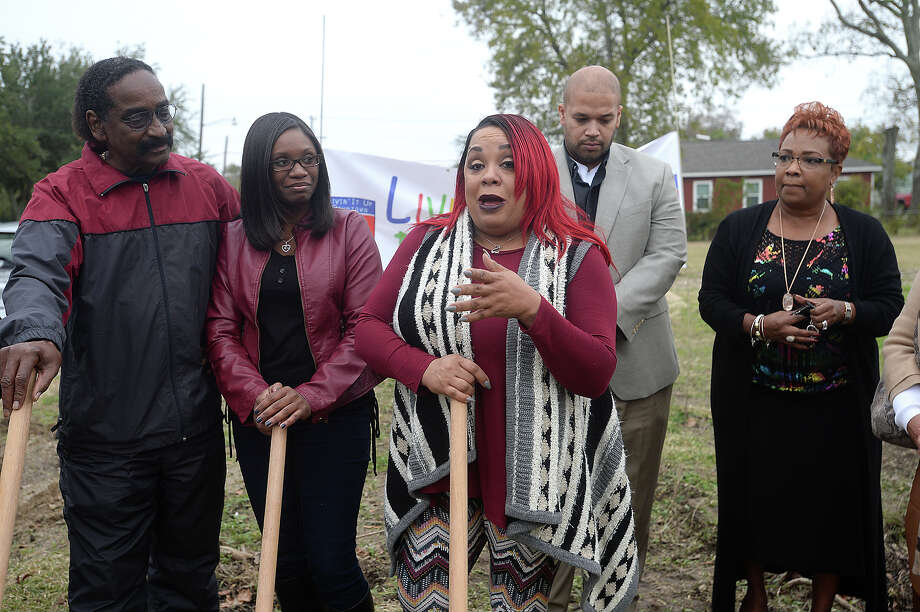 New home owner Deirdre Hines addresses the crowd after joining in a groundbreaking ceremony for her new home on 6th Street as part of the implementation of the new economic development program which was voted in by Port Arthur residents last spring. Legacy Community Development Corporation and the Port Arthur Economic Development Corporation are joining forces for the affordable housing program that will assist new home owners with down payments, thereby increasing home ownership and growth in the community. Affordable housing in Port Arthur and attracting home owners to the city has long been a goal of the economic development groups and city officials. Photo taken Wednesday, December 7, 2016 Kim Brent/The Enterprise Photo: Kim Brent / Beaumont Enterprise