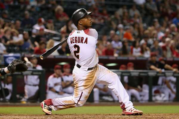 PHOENIX, AZ - APRIL 06:  Jean Segura #2 of the Arizona Diamondbacks bats against the Colorado Rockies during the MLB game at Chase Field on April 6, 2016 in Phoenix, Arizona.  (Photo by Christian Petersen/Getty Images)