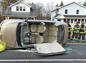 The driver of this car had to be extricated after hitting the lowered ramp of a tractor trailer and flipping over on Old Loudon Road Thursday Dec. 8, 2016 in Colonie, NY.  (John Carl D'Annibale / Times Union)