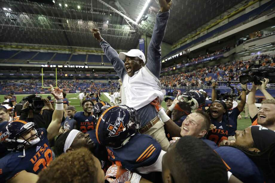 """UTSA players and coach Frank Wilson show their emotion after the Roadrunners became bowl eligible for the first time in program history with a 33-14 win over Charlotte on Nov. 26. Said Wilson: """"Probably the most important thing is we're a smarter team than we were a year ago."""" Photo: Eric Gay /Associated Press / Copyright 2016 The Associated Press. All rights reserved."""