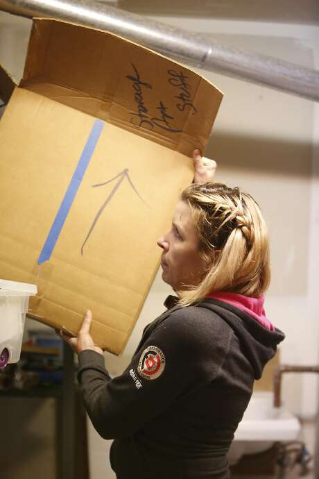 Hawkins goes through belongings last month in preparation for the family's move from Bernal Heights to Truckee. Photo: Lea Suzuki, The Chronicle