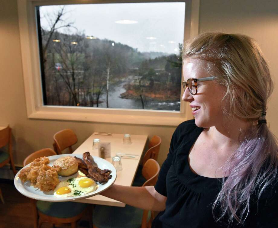 Server Ashley Evans serves up breakfast with a view, eggs, hash browns, bacon and a biscuit under a picture window at Gracie's Luncheonette on Main Street Wednesday Nov. 30, 2016 in Leeds, NY.  (John Carl D'Annibale / Times Union) Photo: John Carl D'Annibale / 20038977A