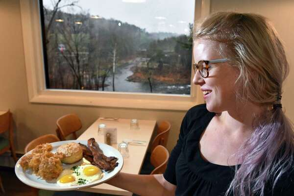 Server Ashley Evans serves up breakfast with a view, eggs, hash browns, bacon and a biscuit under a picture window at Gracie's Luncheonette on Main Street Wednesday Nov. 30, 2016 in Leeds, NY.  (John Carl D'Annibale / Times Union)