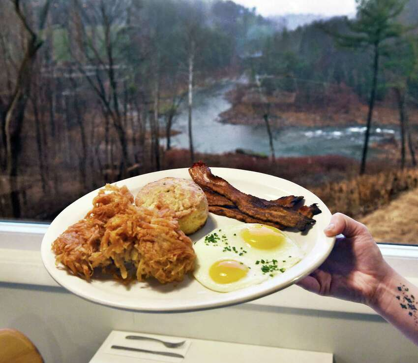 Breakfast with a view, eggs, hash browns, bacon and a biscuit under a picture window at Gracie's Luncheonette on Main Street Wednesday Nov. 30, 2016 in Leeds, NY. (John Carl D'Annibale / Times Union)