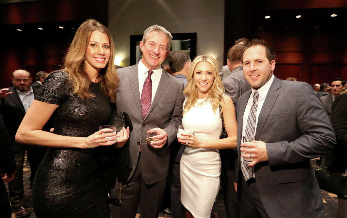 Abbey Nowlin, from left, Scott Harris, Jennifer Simmons and Keith Bradley pose for a photo at Spec's Charitable Foundation Vintage Virtuoso Gala, benefiting the Houston Symphony, at Royal Sonesta Hotel Houston Wednesday, Dec. 7, 2016, in Houston.