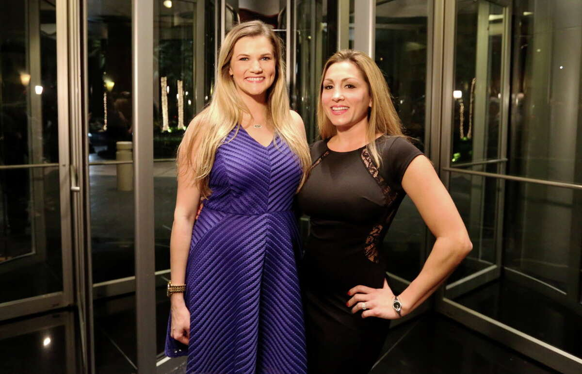 Danielle Story, left, and Corrine Lowder pose for a photo at Spec's Charitable Foundation Vintage Virtuoso Gala, benefiting the Houston Symphony, at Royal Sonesta Hotel Houston Wednesday, Dec. 7, 2016, in Houston.