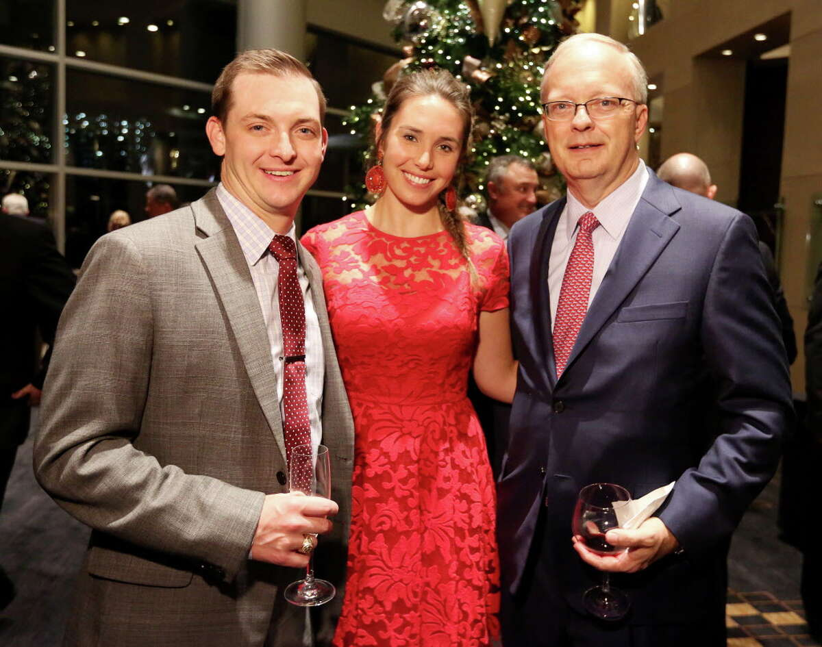 Jameson Burke, left, Anna Schroeder and Joe Patterson pose for a photo at Spec's Charitable Foundation Vintage Virtuoso Gala, benefiting the Houston Symphony, at Royal Sonesta Hotel Houston Wednesday, Dec. 7, 2016, in Houston.