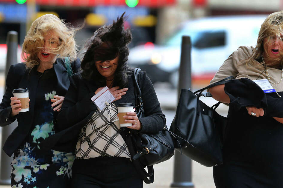 Pedestrians brave high winds Thursday December 8, 2016 while crossing Market street at the intersection of Bowie at the Henry B. Gonzalez Convention Center in downtown San Antonio. The National Weather Service has issued a wind advisory for most of central Texas with gusts as high as 40 mile per hour.