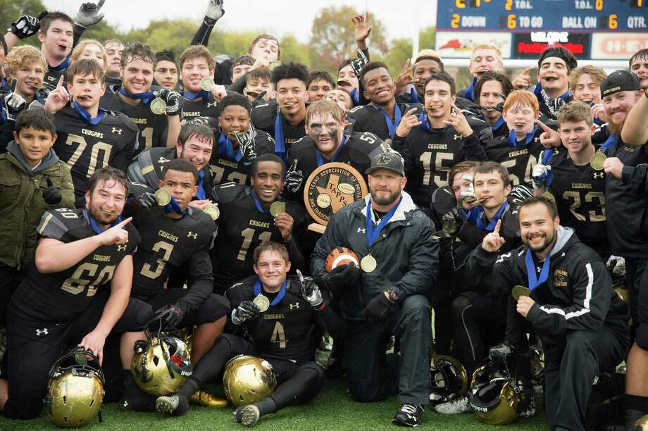 The Northland Christian Cougars gather for a photograph following the 21-17 state title win over Covenant Christian in Waco Saturday. The Cougars completed a perfect 14-0 season with a thrilling, come-from-behind win over Covenant Christian. Photo: C/o Dan Long, Northland Christian / Dan Long