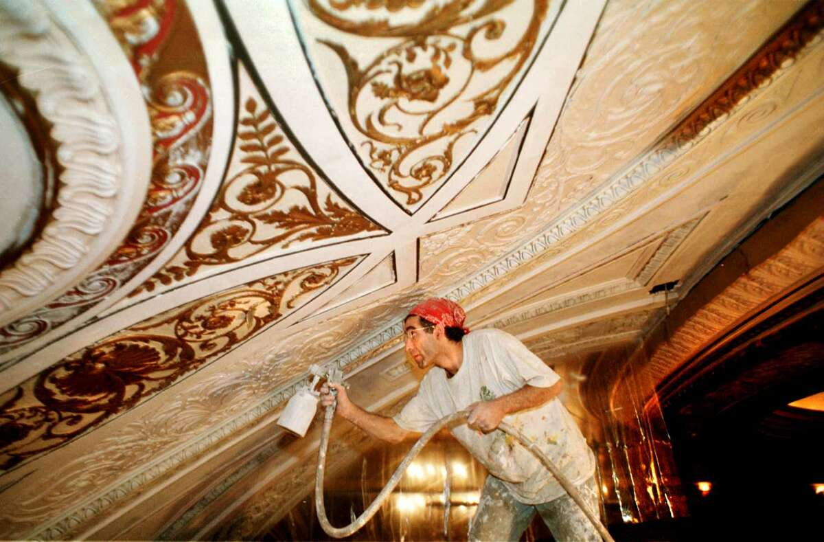 Decorative restoration painter Chedly Gassao works on the ceiling at Proctors Theatre in Schenectady on July 18, 1997. (Michael P. Farrell/Times Union archive)