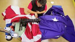 Lucy Rodriguez sews an American flag at Dixie Flag & Banner Co., one of five from the company that will hang from the U.S. Capitol on Jan. 20 during Donald Trump's inauguration.