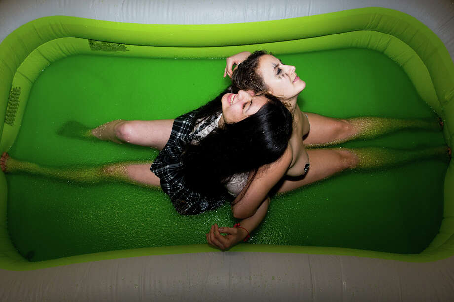 Sailor Doom and Brawnhilda prepare to wrestle in a pool of green jello at Jello Underground at Evlov Fitness in South Lake Union on Friday, Jan. 9, 2016. The event came back after a long hiatus, filling the gym with spectators. Photo: GRANT HINDSLEY, SEATTLEPI.COM / SEATTLEPI.COM