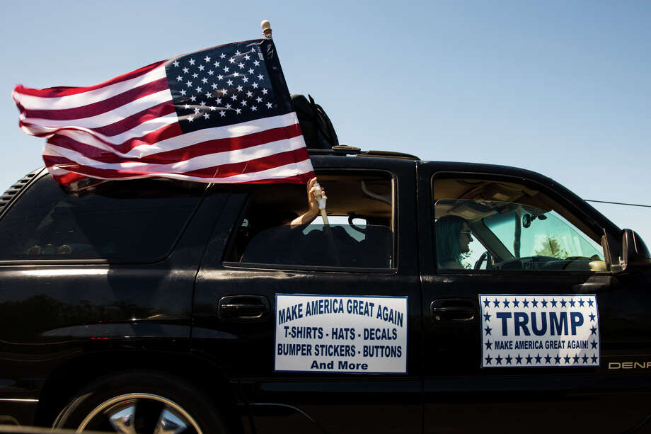 An American flag flies out of the window of a truck headed towards the Donald Trump rally at the Northwest Washington Fair and Event Center in Lynden, Wash. on Saturday, May 8, 2016. Photo: GRANT HINDSLEY, SEATTLEPI.COM / SEATTLEPI.COM