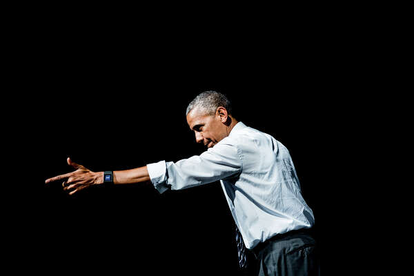 President Barack Obama points at the crowd as he walks off stage during a Democratic fundraiser at the Washington State Convention Center on Friday, June 24, 2016.