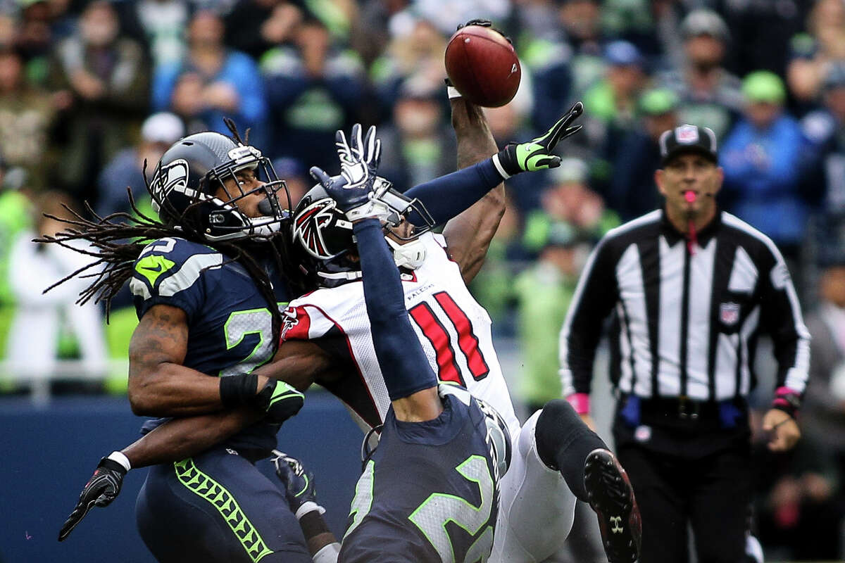Seahawks corner back Richard Sherman breaks up a long pass meant for Falcons wide receiver Julio Jones on fourth down in the fourth quarter at CenturyLink Field, Sunday, Oct. 16, 2016. The end of the game call was highly contested, and was credited with the Seahawks' win.