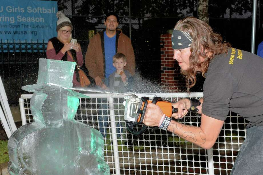 West University Place went all out to welcome in the season on Monday, Dec. 5. Residents turned out to enjoy the lights, an ice carver and goodies as well as a visit from Santa Claus himself. Photo: Craig Moseley / HCN Staff, Staff / ©2016 Houston Chronicle