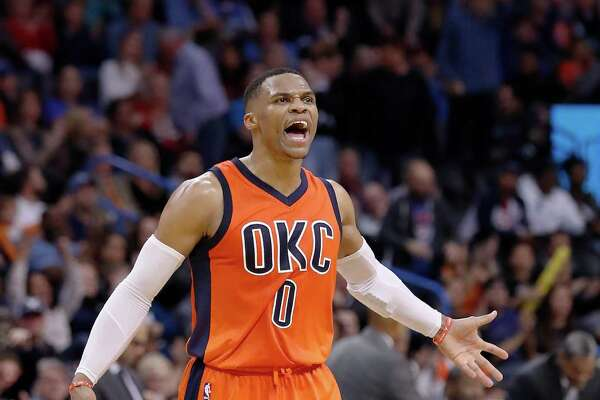 Oklahoma City Thunder guard Russell Westbrook (0) reacts after shooting a 3 point basket against the New Orleans Pelicans during the second half of an NBA basketball game in Oklahoma City, Sunday, Dec. 4, 2016. Oklahoma City won 101-92. (AP Photo/Alonzo Adams)