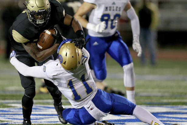 Foster's Cedarian Lamb, left, has run roughshod over opponents such as San Antonio Alamo Heights'  Holden Daum during the postseason. Last week against Dripping Springs, Lamb erupted for nine catches, 226 yards and five touchdown receptions.