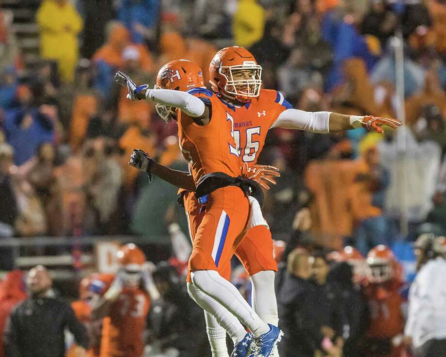 Sam Houston State's Carlos Teal (Left) and A.J. Davis (Right) celebrate after Chattanooga turned the ball over on downs in a NCAA Division I Football Championship Subdivision playoff football game at Bowers Stadium on Saturday, December 3, 2016, in Huntsville, Tx. (Joe Buvid / For the Houston Chronicle) Photo: Joe Buvid, Freelance / © 2016 Joe Buvid