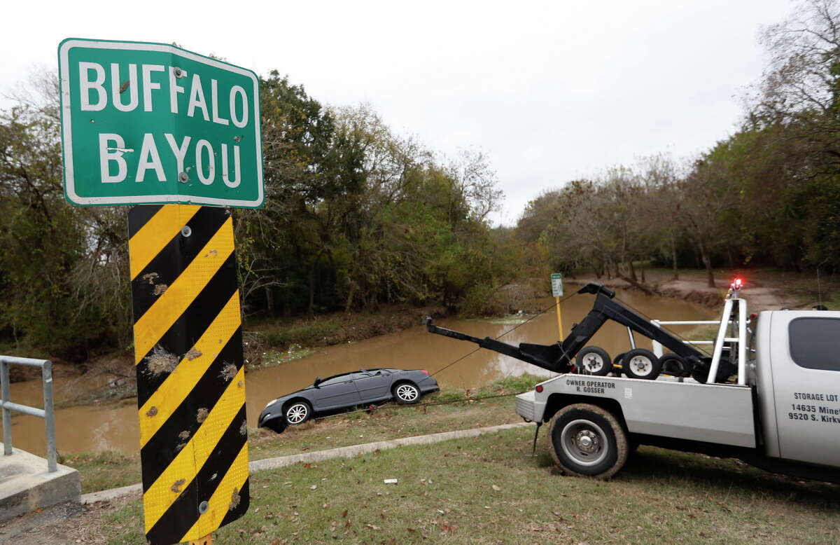 Houston police investigate the scene after a car was submerged in Buffalo Bayou in George Bush Park at 16800 Wertheimer Parkway, Thursday,Dec. 8, 2016 in Houston. One body was found inside the vehicle.