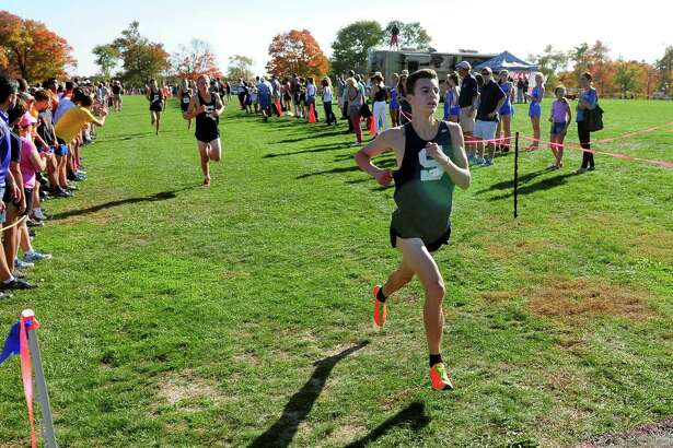 Staples' William Landowne crosses the finish line in FCIAC Girls Cross Country Championship race action at Wavenly Park in New Canaan, Conn. on Wednesday Oct. 19, 2016.