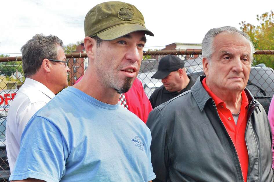 In this October 2013 photo, Albany Street business owners Dean Plakas, left, of Newest Lunch and Charles Craft of Chas. Burch Plumbing announce an initiative to clean up an Albany Street neighborhood in Schenectady, NY. (John Carl D'Annibale / Times Union)