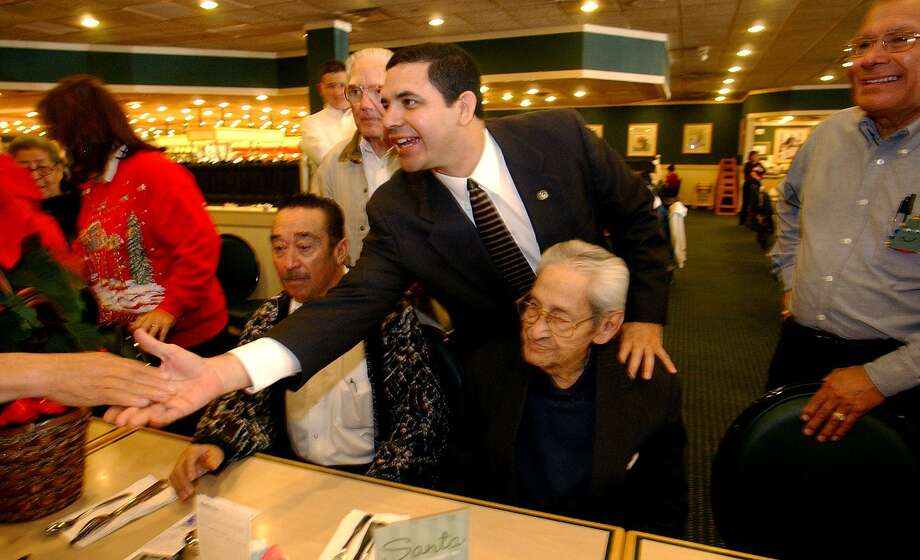 Henry Cuellar, now a Democratic congressman, visits with potential voters at Hometown Buffet off Southwest Military Drive on Dec. 19, 2003. The buffet's parent company Buffet LLC filed for Chapter 11 bankruptcy protection in March. Photo: KIN MAN HUI /SAN ANTONIO EXPRESS-NEWS / SAN ANTONIO EXPRESS-NEWS