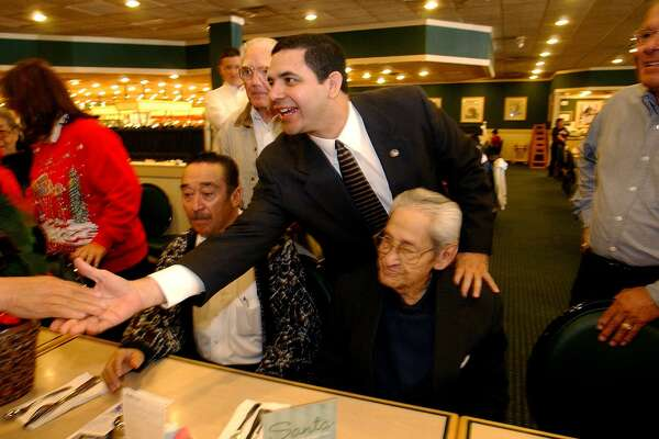 Henry Cuellar, now a Democratic congressman, visits with potential voters at Hometown Buffet off Southwest Military Drive on Dec. 19, 2003. The buffet's parent company Buffet LLC filed for Chapter 11 bankruptcy protection in March.