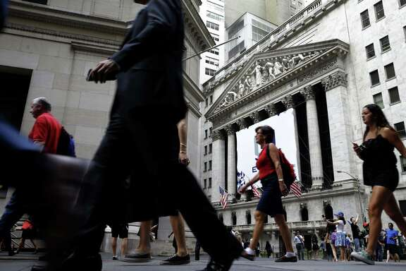 The Federal Reserve said real estate values increased $554 billion in the third quarter, while Americans' stock and mutual fund portfolios rose $494 billion.