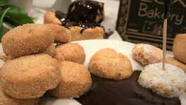 This recipe for bizcochitos, a shortbread-like cookie, includes a liqueur-infused chocolate sauce. The recipe comes from Lux Bakery of San Antonio.