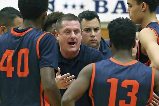 Brandeis coach Marc Gardner talks to his players during a game against O'Connor at Taylor Field House on Jan. 22, 2016.