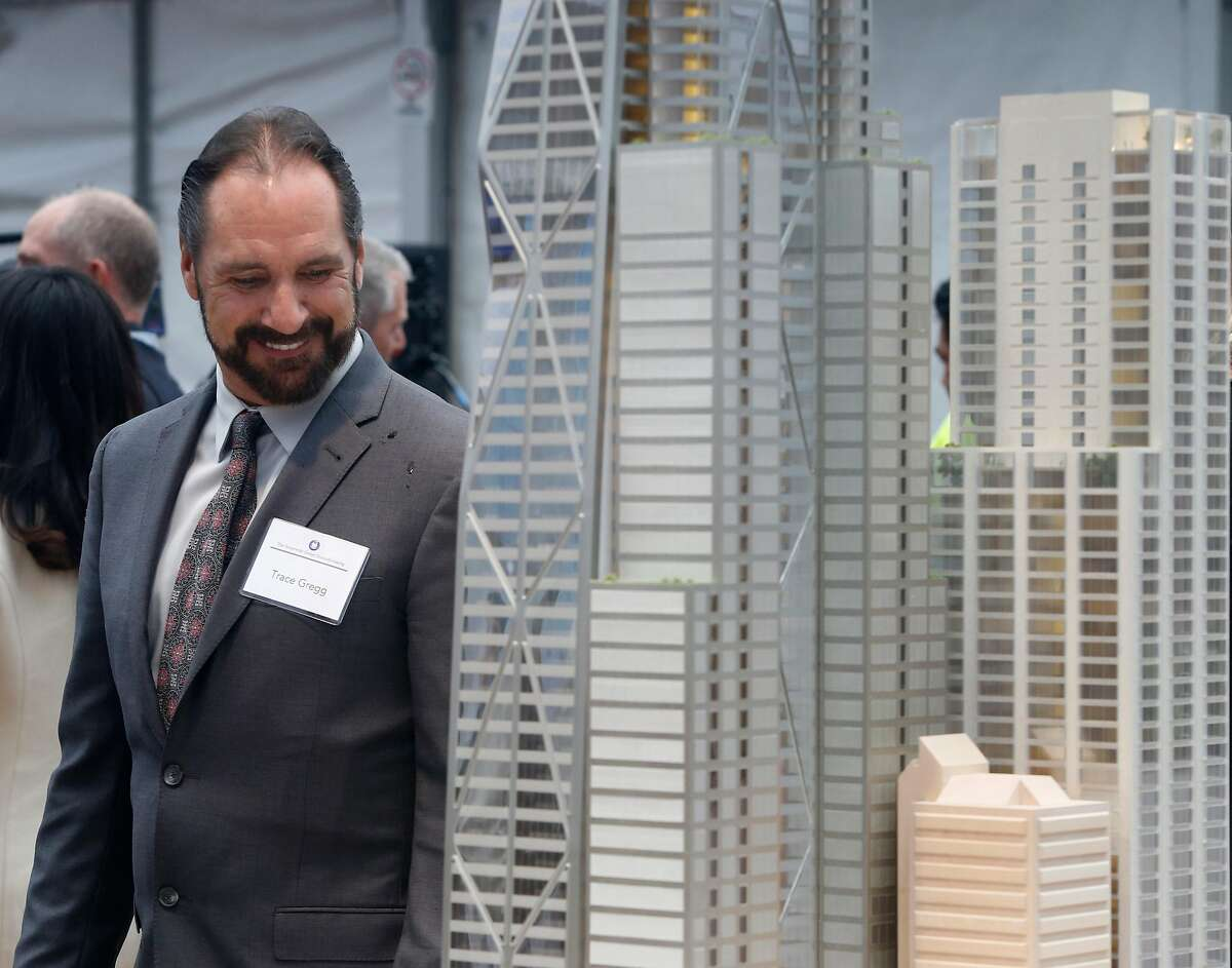 Trace Gregg takes a look at a model of the Oceanwide Center project at the groundbreaking ceremony for the 910-foot, 61-story tower in San Francisco, Calif. on Thursday, Dec. 8, 2016. When completed in 2021, the residential and office building on First Street will be the second tallest building in the city.