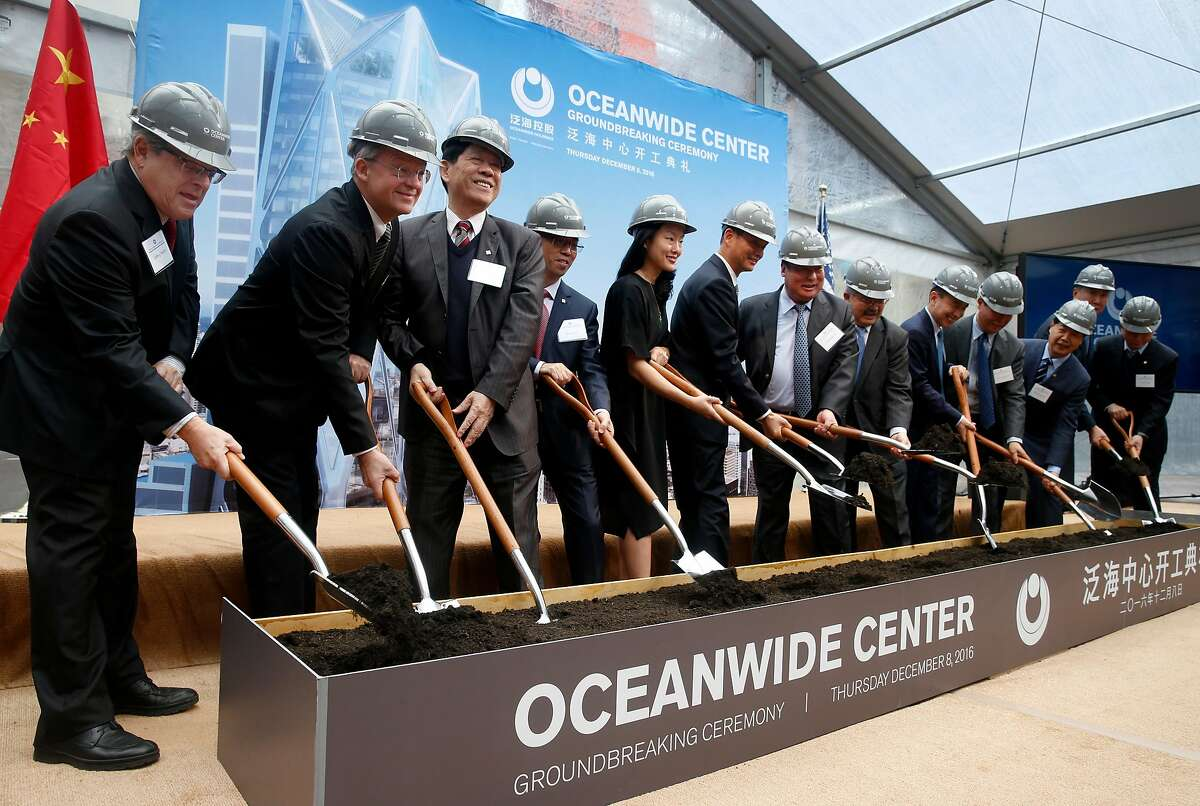 Dignitaries shovel dirt at the groundbreaking ceremony for the 910-foot, 61-story Oceanwide Center in San Francisco, Calif. on Thursday, Dec. 8, 2016. When completed in 2021, the residential and office tower on First Street will be the second tallest building in the city.