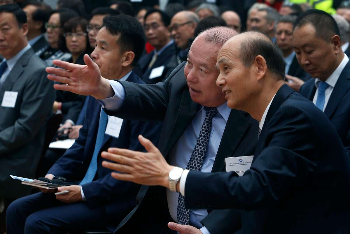 China Oceanwide Holdings Group chairman Lu Zhiqiang (left) speaks with Luo Linquan, China's Consul General in San Francisco, at the groundbreaking ceremony for the 910-foot, 61-story Oceanwide Center in San Francisco, Calif. on Thursday, Dec. 8, 2016. When completed in 2021, the residential and office tower on First Street will be the second tallest building in the city.
