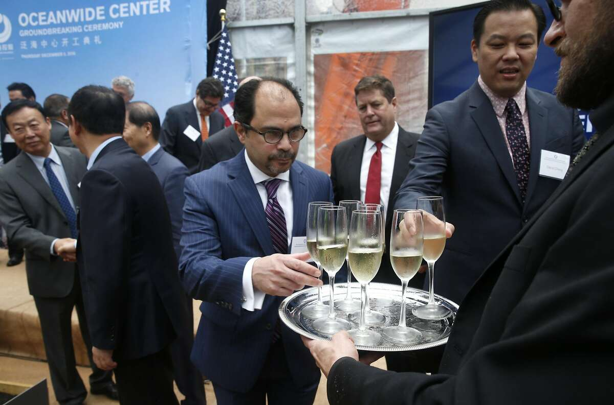 Champagne is served to guests to celebrate the groundbreaking for the 910-foot, 61-story Oceanwide Center in San Francisco, Calif. on Thursday, Dec. 8, 2016. When completed in 2021, the residential and office tower on First Street will be the second tallest building in the city.