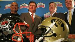 Coaches for the Valero Alamo Bowl — Oklahoma State's Mike Gundy (left) and Colorado's Mike MacIntyre — conduct their first news conference at The Club at Sonterra on Dec. 8, 2016. On far left is Lamont Jefferson and on far right is Gary Simmons.
