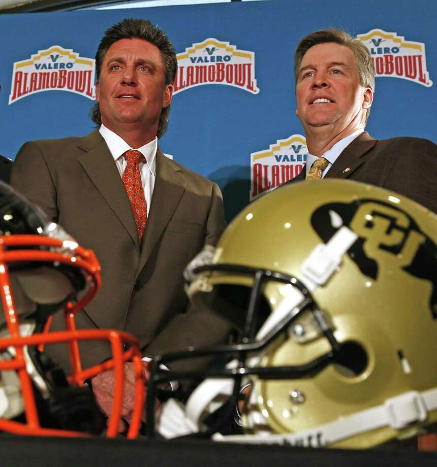 Coaches for the Valero Alamo Bowl — Oklahoma State's Mike Gundy (left) and Colorado's Mike MacIntyre — conduct their first news conference at The Club at Sonterra on Dec. 8, 2016. Photo: Ron Cortes /For The Express-News / Freelance