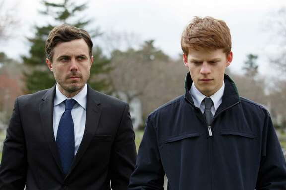 """This image released by Roadside Attractions and Amazon Studios shows Lucas Hedges, right, and Casey Affleck in a scene from """"Manchester By The Sea."""" The film has been named best film by the National Board of Review, which lavished four awards on Kenneth Lonergan's New England portrait of grief. In awards announced Tuesday by the National Board of Review, """"Manchester by the Sea"""" also took best actor for Casey Affleck's lead performance, best screenplay for Lonergan's script and best supporting actor for the breakout performance by Lucas Hedges. (Claire Folger/Roadside Attractions and Amazon Studios via AP)"""