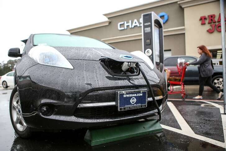 An electric car uses a public charging stations in the Stonestown Galleria parking lot on Thursday, December 8, 2016 in San Francisco, Calif.