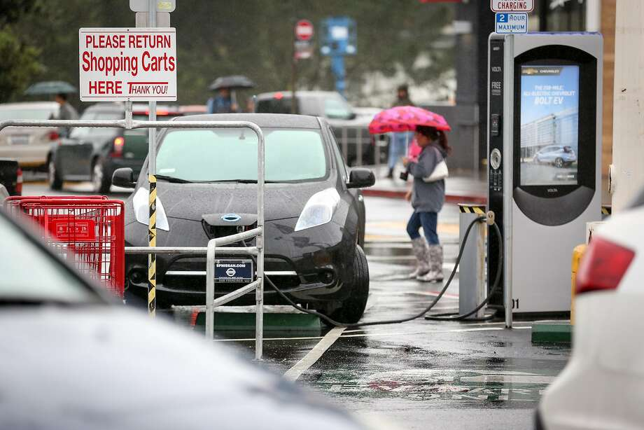 An electric car uses one of the two public charging stations in the Stonestown Galleria parking lot on Thursday, December 8, 2016 in San Francisco, Calif. Photo: Amy Osborne, Special To The Chronicle